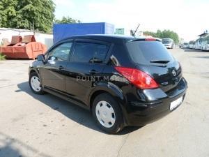 Тонирование стекол Nissan Tiida пленкой SunTek HP 15